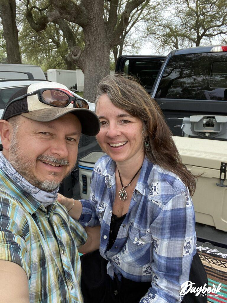 two people sitting on a tailgate