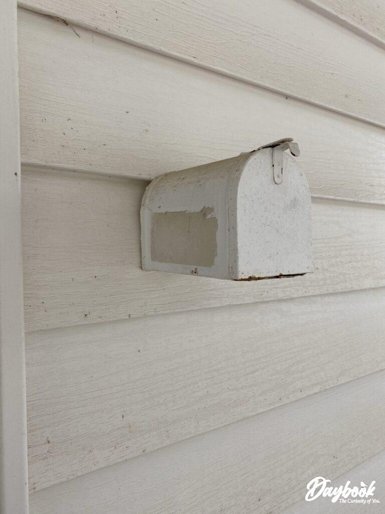 tiny mailbox on the wall
