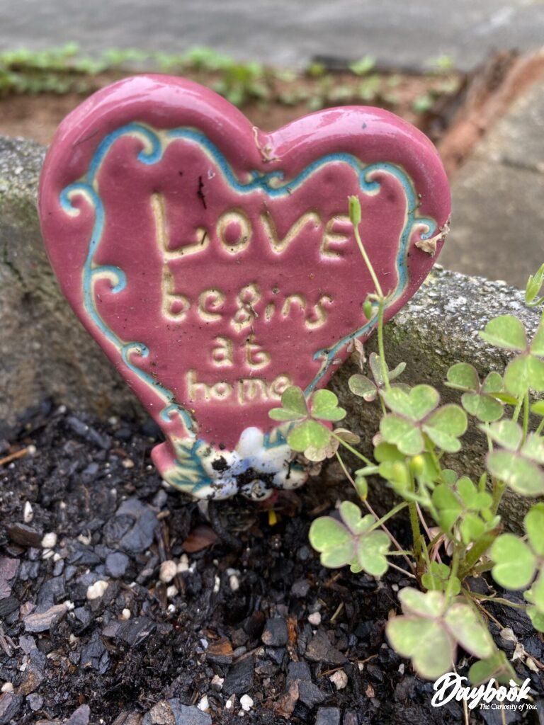 love begins at home garden sign
