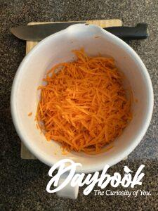grated carrots in a bowl