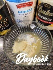 yogurt, mayonnaise, and pineapple juice in a bowl