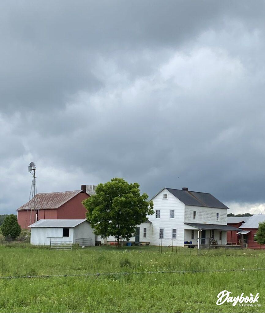 Amish farm with white house and red barn