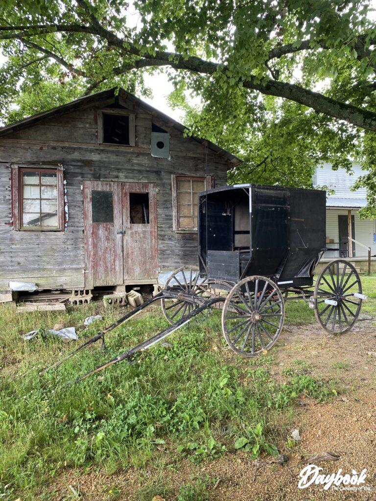 Old Amish barn with buggy in front